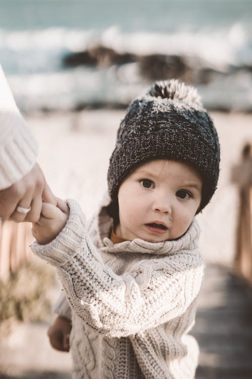 Photo Of Toddler Wearing Knitted Sweater