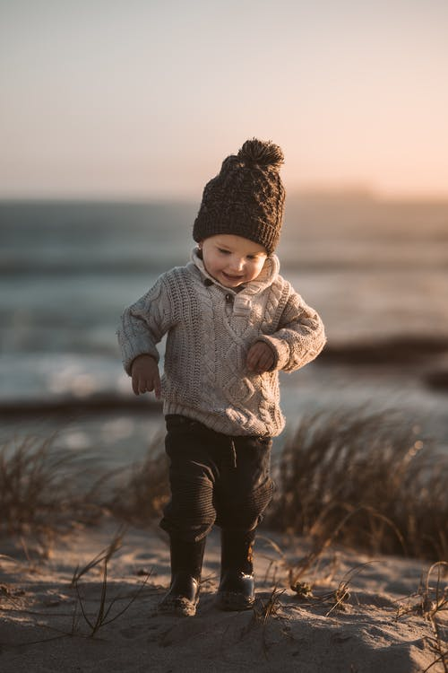 Photo Of Toddler Walking On Sand