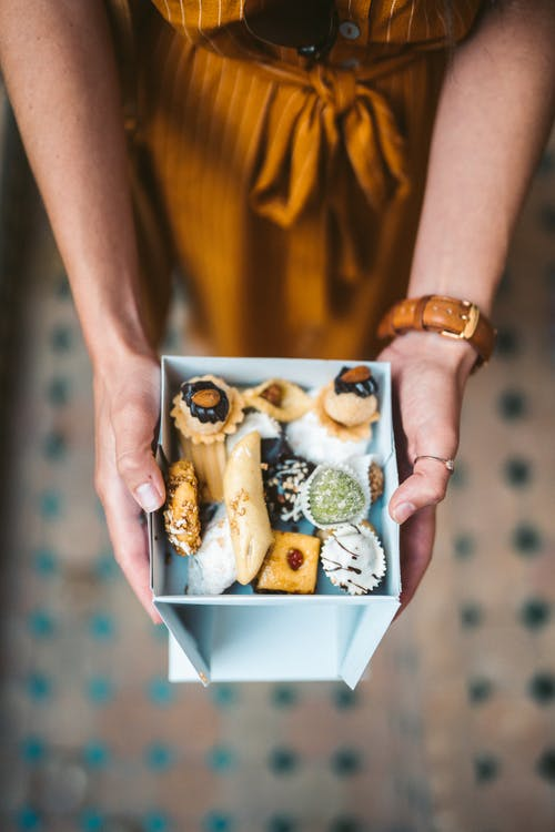 Person Holding Box With Pastries