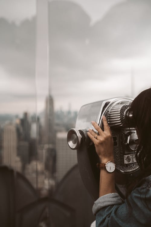 Woman Using A Tower Viewer