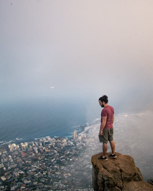 Photo Of Person Standing On A Cliff