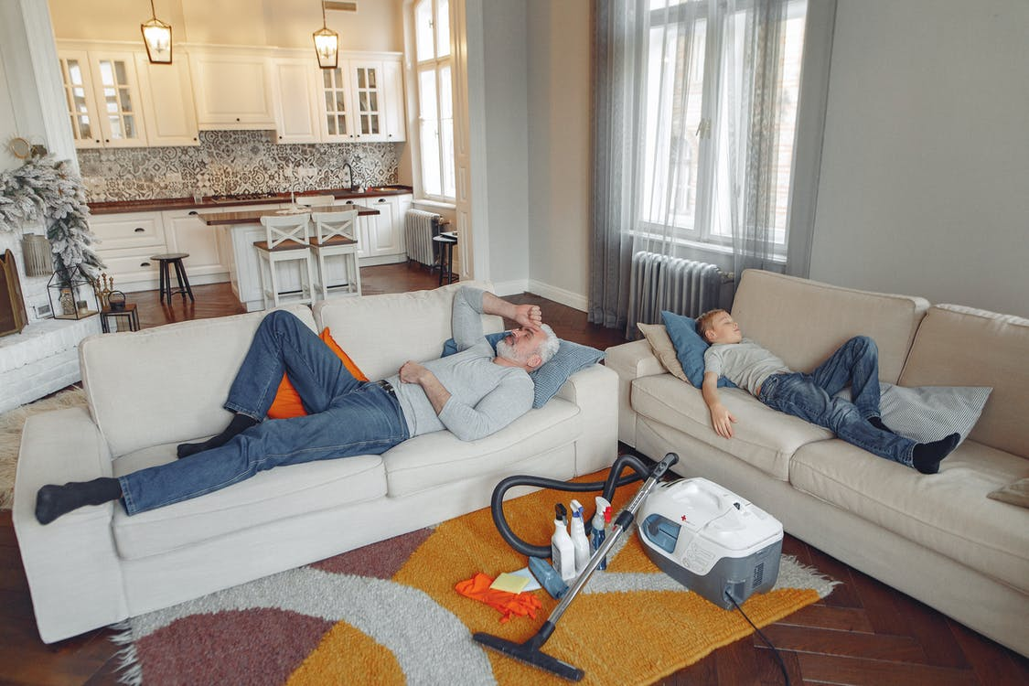 Photo Of People Laying On Couch