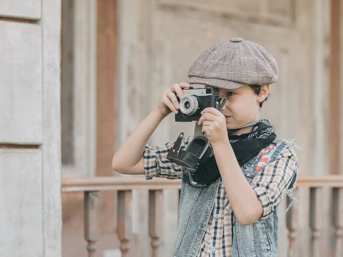 Photo Of Boy Holding Camera