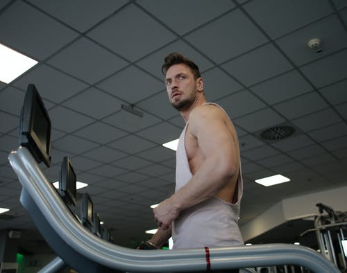 Photo Of Man Using Treadmill
