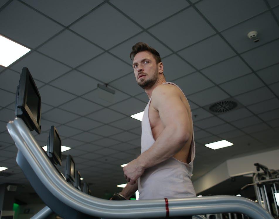 Photo Of Man Using Treadmill