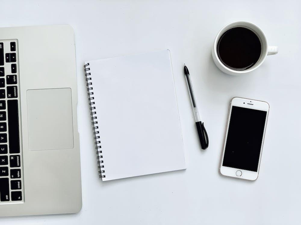 Photo Of Laptop Beside Notebook