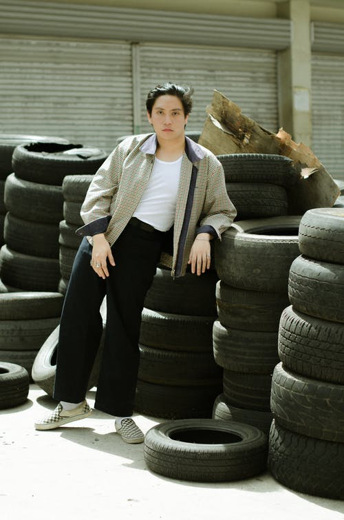 Photo Of Man Leaning On Tires