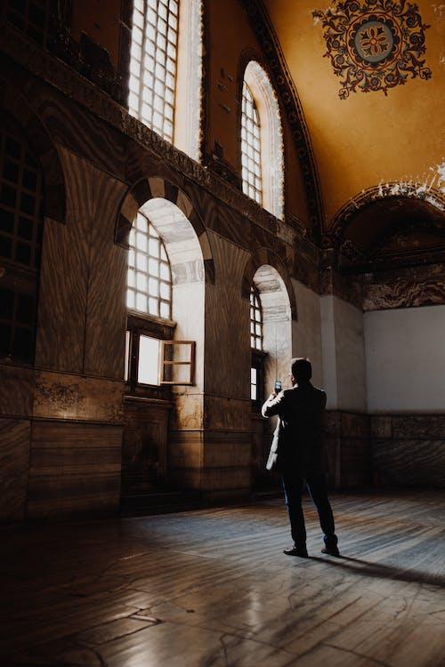 Man Standing Inside A Building