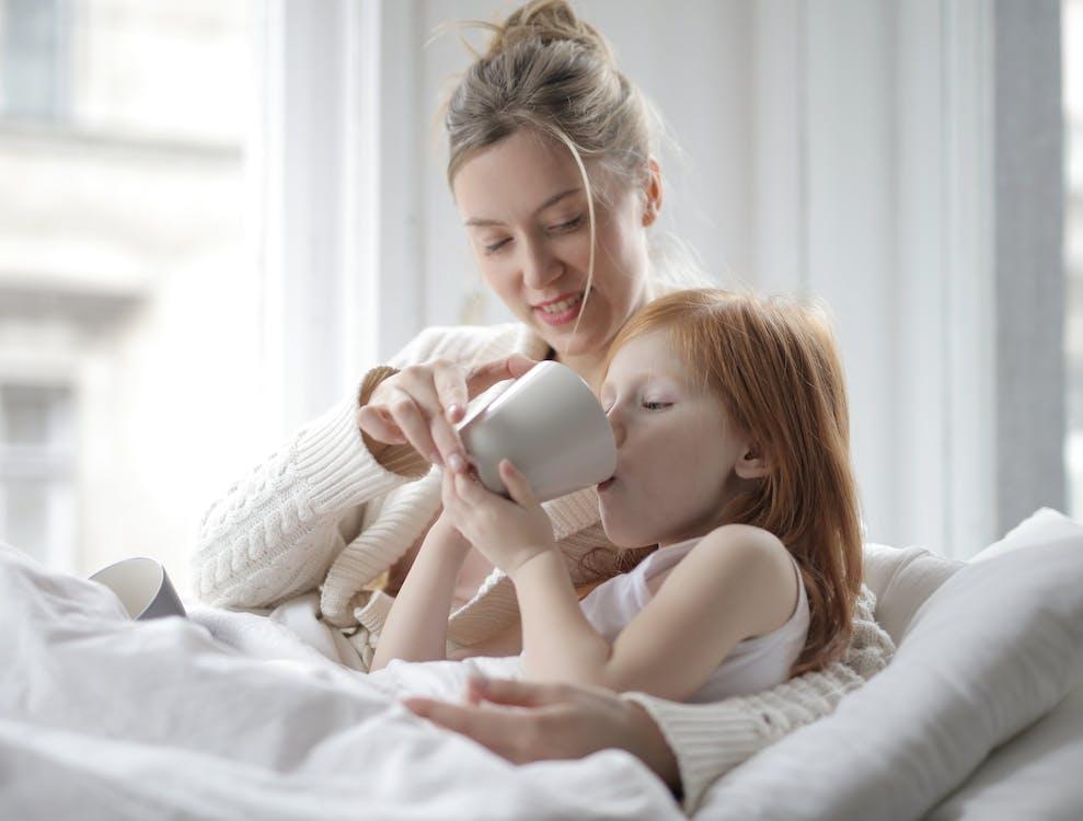 Photo Of Girl Drinking On Mug
