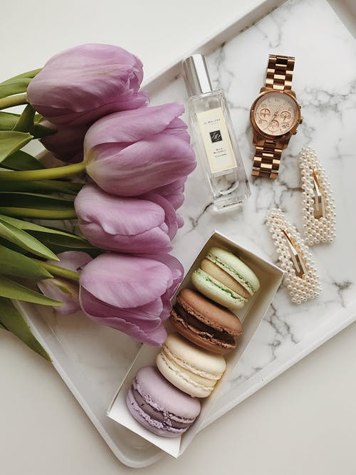 Flat Lay Shot Of Macaroons And Flowers