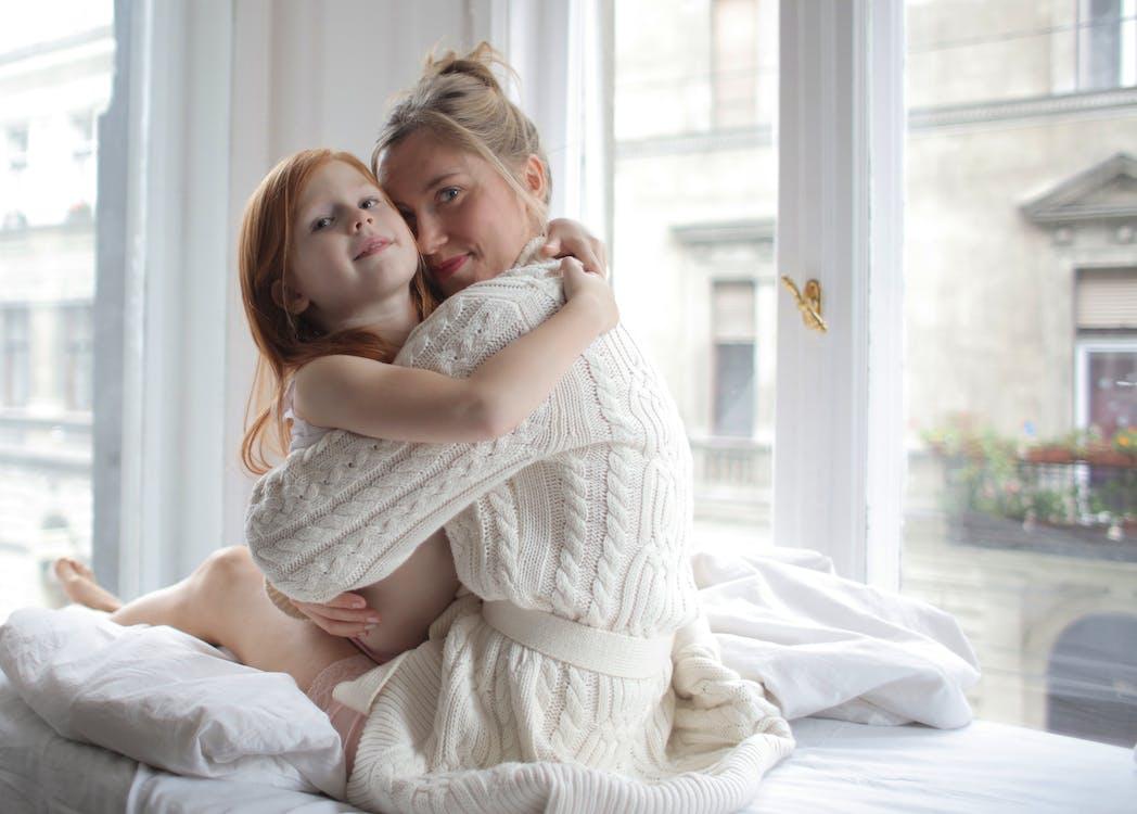 Photo Of Woman Embracing Child