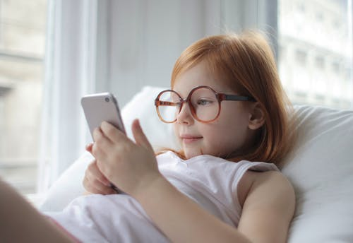 Photo Of Child Using Smartphone