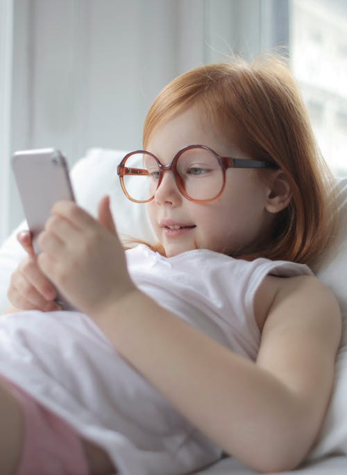 Photo Of Child Using Smartphone