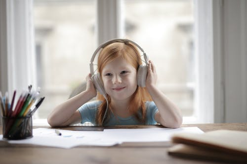 Photo Of Child Wearing Headphones