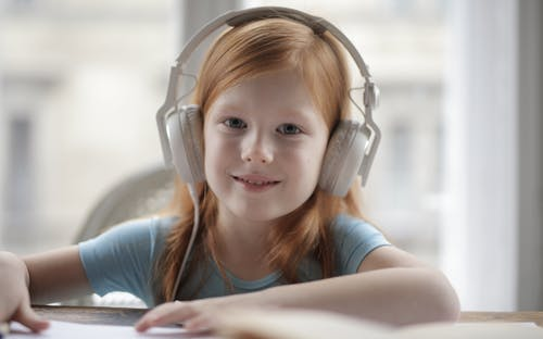 Photo Of Girl Using Headphones