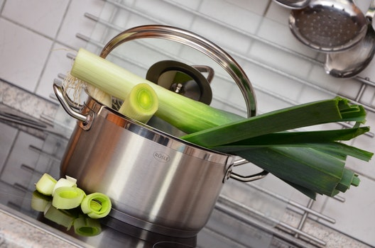 White and Green Vegetable on Top of Stainless Steel Cooking Pot
