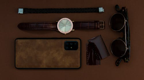 Flatlay Photo Of Accessories And Mobile Phone