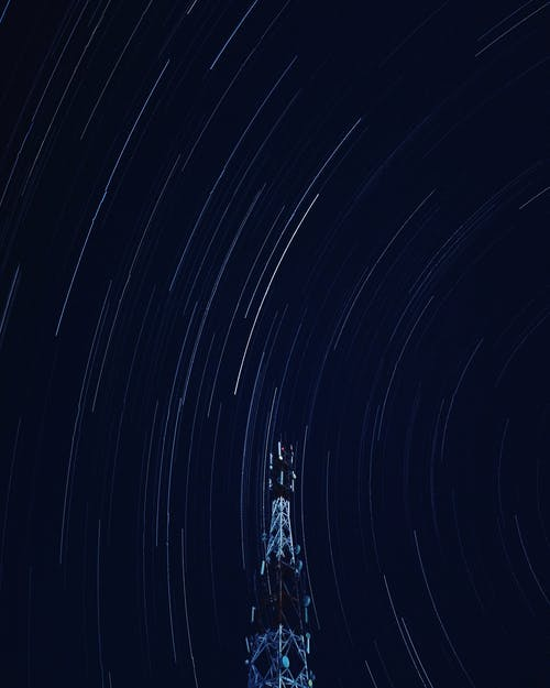 Long Exposure Shot Of Tower Under Starry Sky