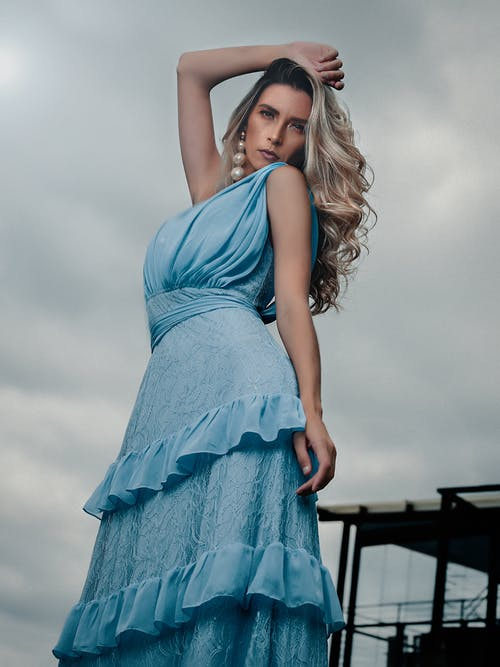 Photo Of Woman Wearing Blue Dress