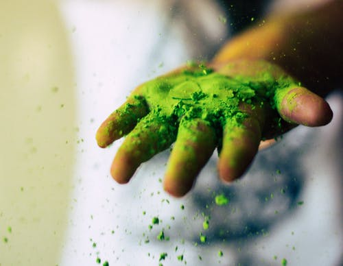 Someone Holding Green Powder
