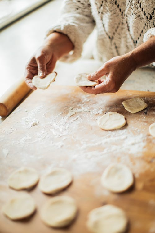 Person Holding Dough on her hands