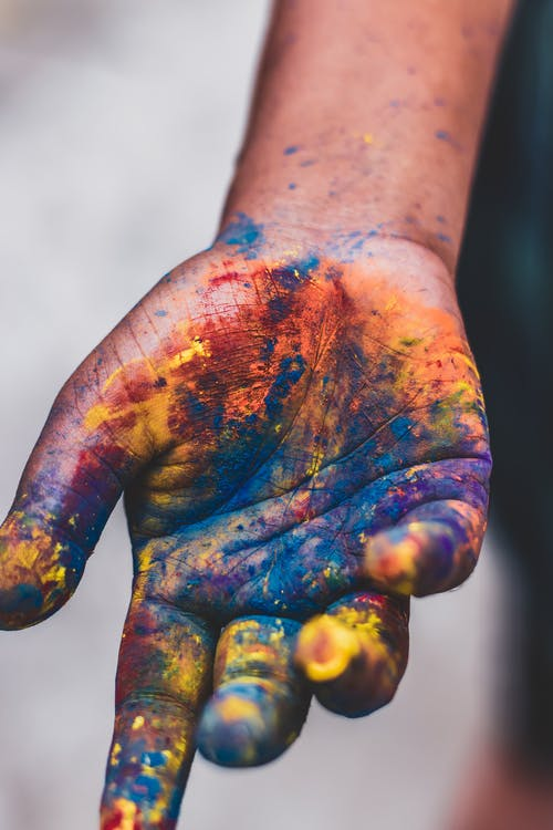 Photo Of Person's Hand With Paint Colors