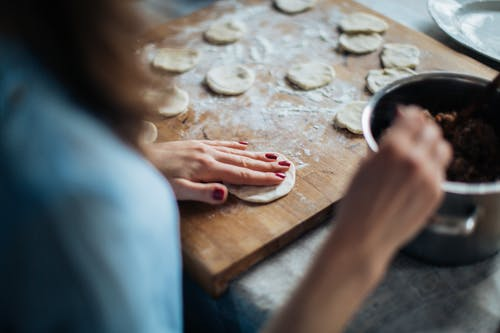 Photo Of Person Pressing Dough