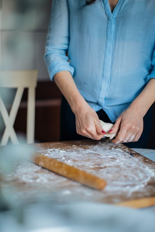Photo Of Person Holding Dough