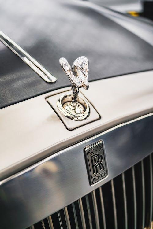 Close-up Photo of Rolls Royce Car Emblem