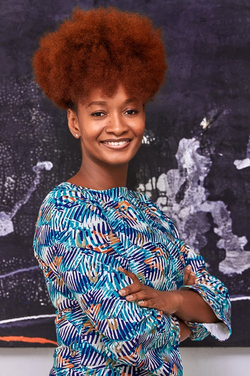 Woman in Blue and White Floral Top Smiling