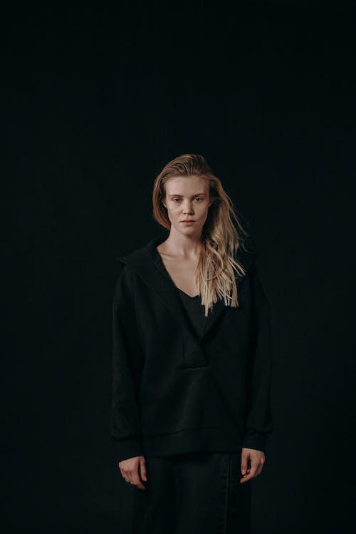 Woman in Black Hoodie and Black Skirt Standing