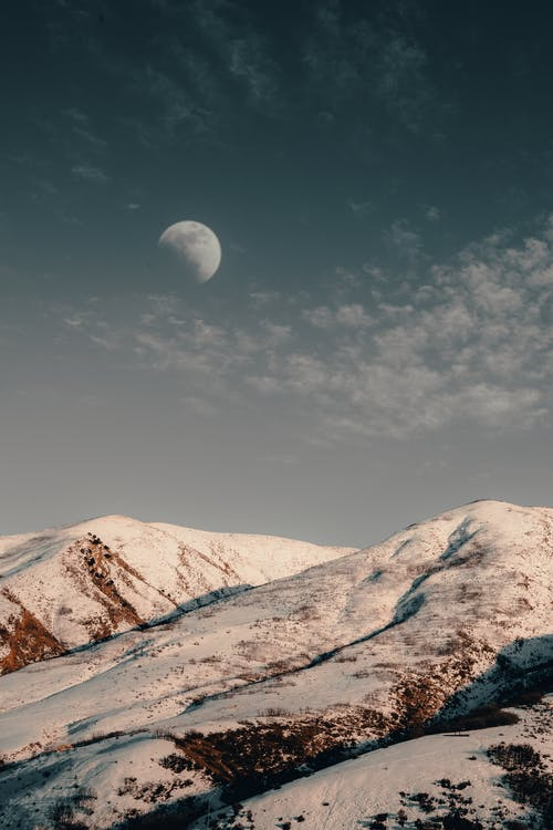 Snow Capped Mountains under Moon