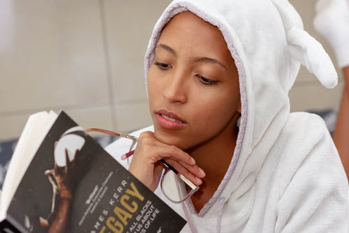 Woman In White Hoodie Holding Book