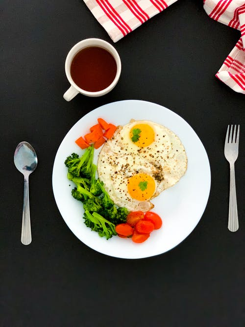 Egg And Vegetable On White Ceramic Plate