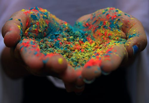 Hands Covered In Colored Powder