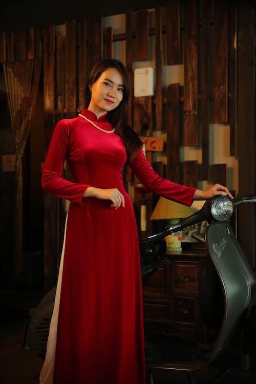 Woman In Red Long Sleeve Dress Standing Beside Motorcycle