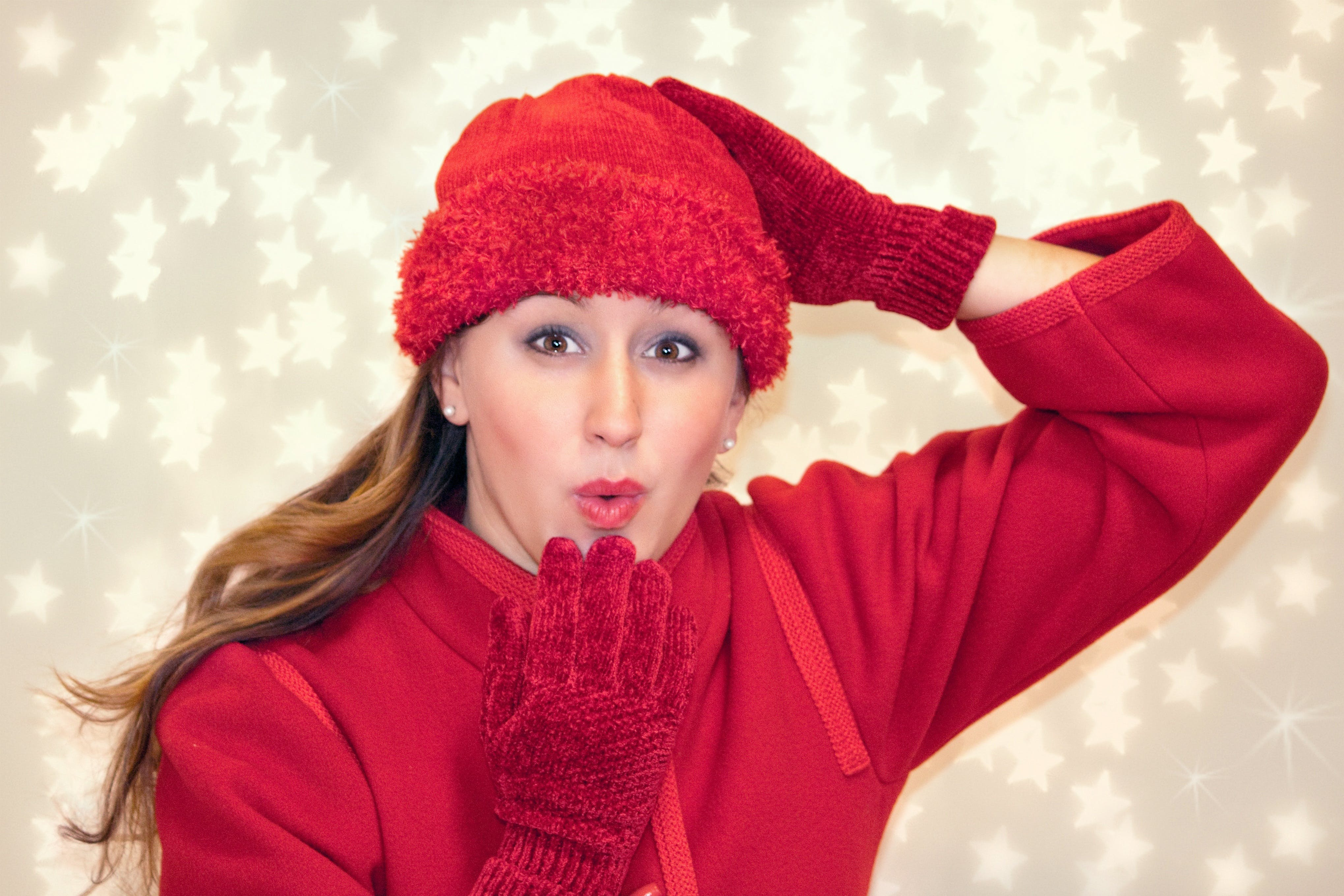 Woman Wearing Red Knitted Hat Doing Pose