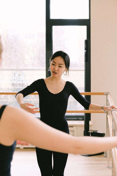 Woman In Black Long Sleeve Shirt Doing Ballet