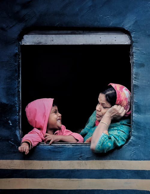 Woman Wearing Pink Hijab With A Kid Inside A Train