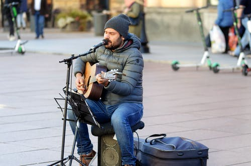 Man Playing Music In The Street