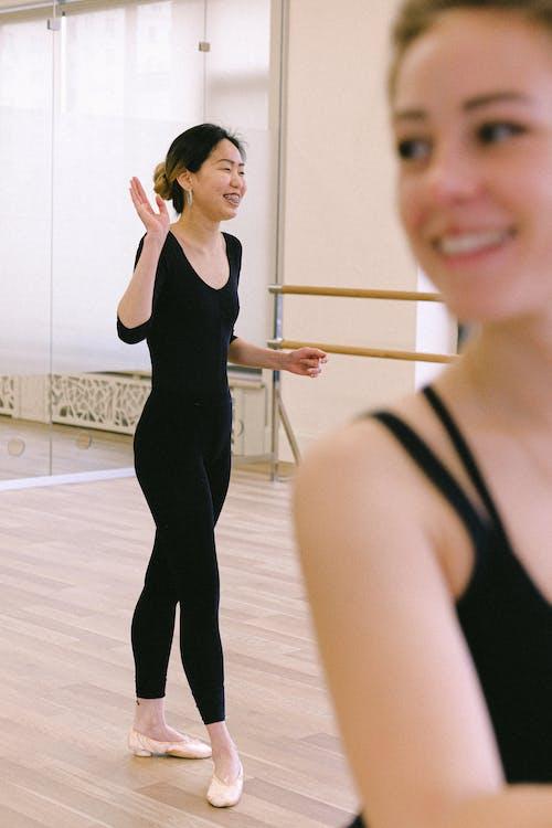 Woman In Black Top And Black Leggings