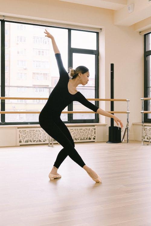 Woman In Black Tank Top And Black Leggings Dancing