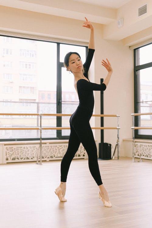 Woman In Black Top And Black Leggings Doing Ballet