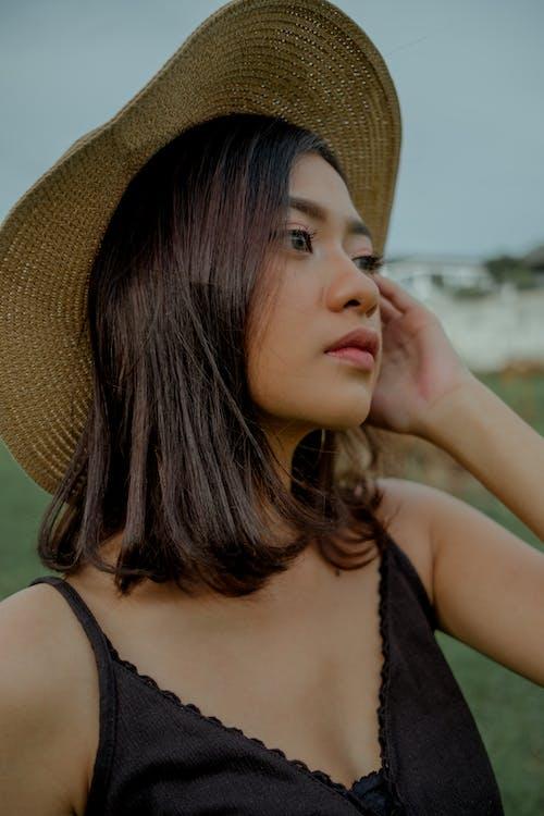 Woman In Black Tank Top Wearing Brown Sun Hat