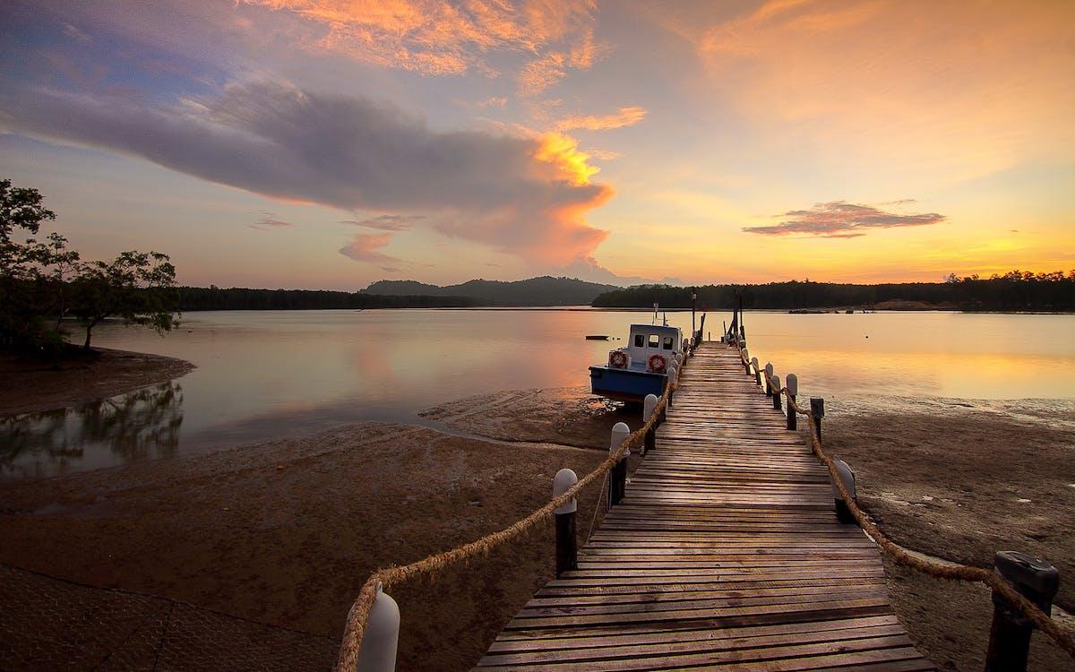 White Boat Beside Wooden Dock