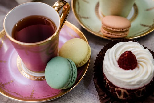 Teacup And Macarons On A Saucer
