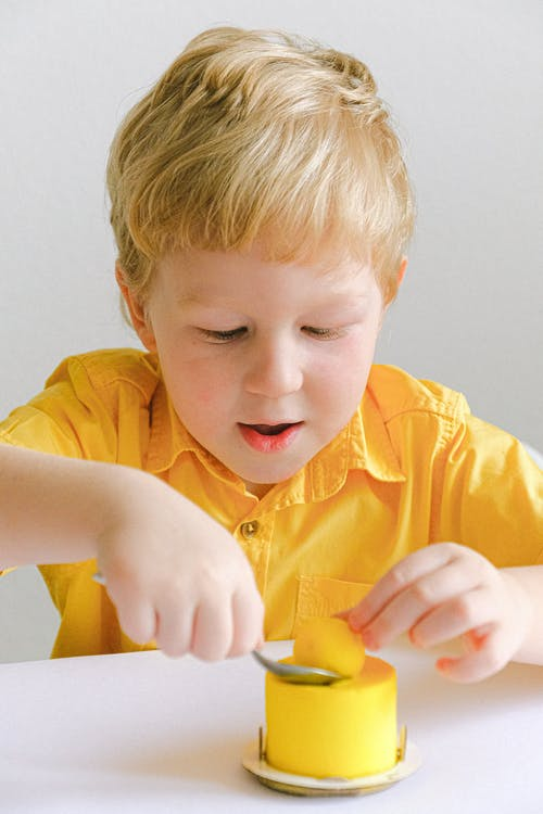 Boy In Yellow Polo Shirt About To Eat Cake