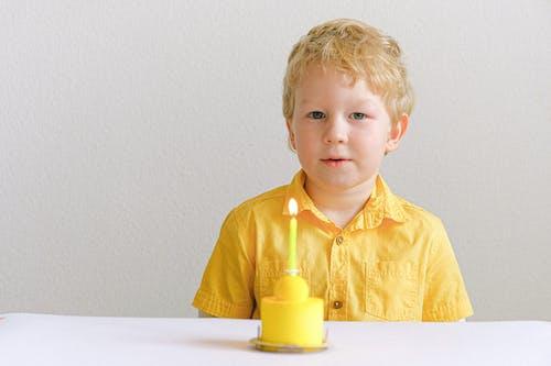 Boy In Yellow Button Up Shirt