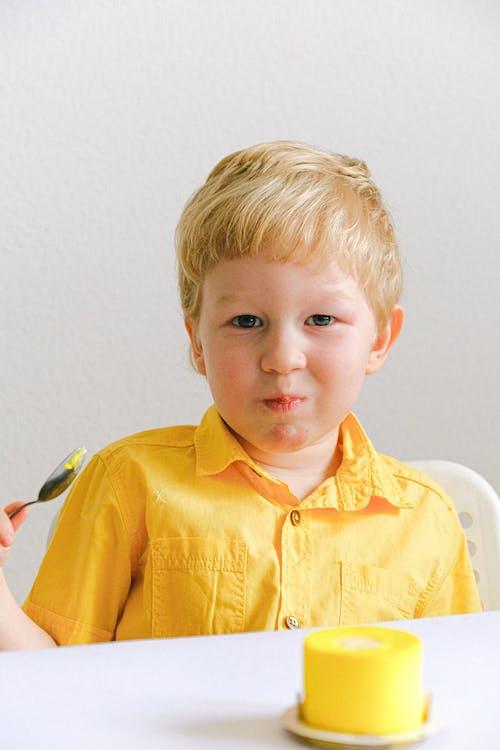 Boy Eating Cake