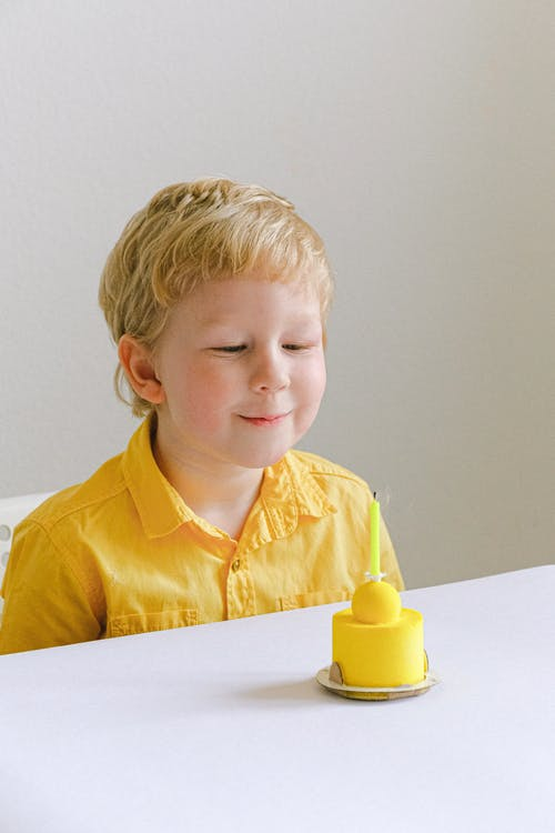 Boy In Yellow Polo Shirt